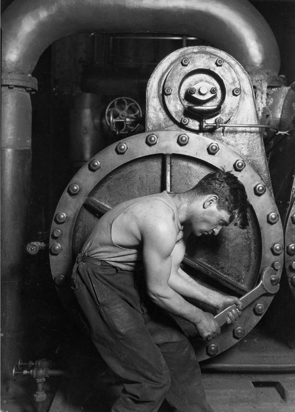 """Power house mechanic working on steam pump"" By Lewis Hine, 1920 National Archives and Records Administration"